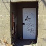 Vandalized Door & Exterior Wall